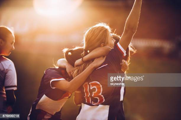 celebrating the victory after soccer match! - girls stock pictures, royalty-free photos & images