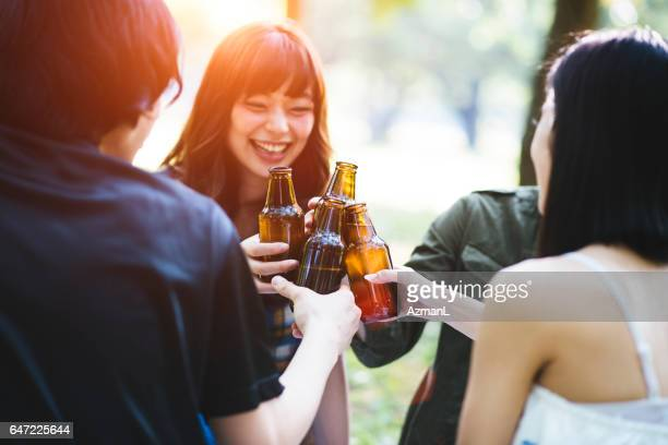 celebrating togetherness - asian drink stock photos and pictures