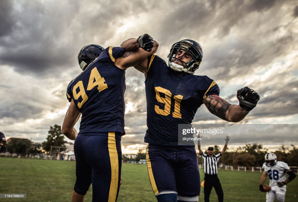 Celebrating victory after American football match! : Stock Photo