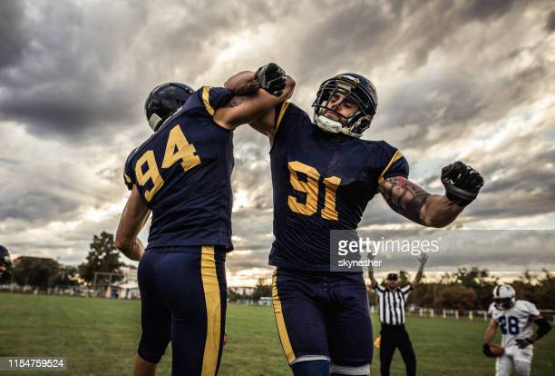 celebrating victory after american football match! - american football referee stock pictures, royalty-free photos & images