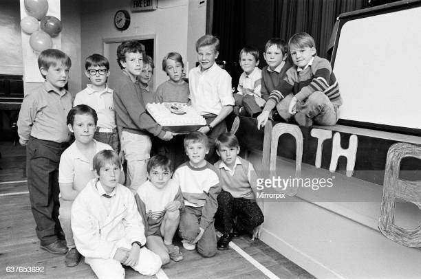 Celebrating was a piece of cake for these members of the 2nd Huddersfield Boys' Brigade who had a disco and party at their headquarters at Moldgreen...
