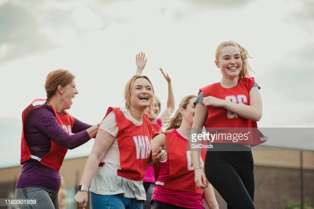 celebrating with teammates! - chanting stock pictures, royalty-free photos & images