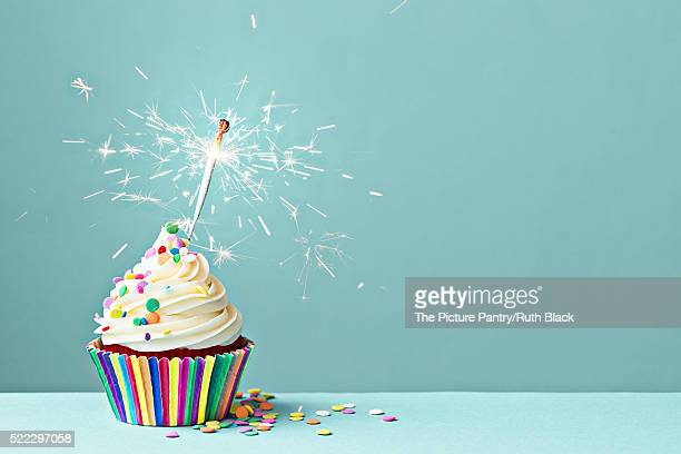 celebration cupcake with sparkler - birthday cake stock pictures, royalty-free photos & images