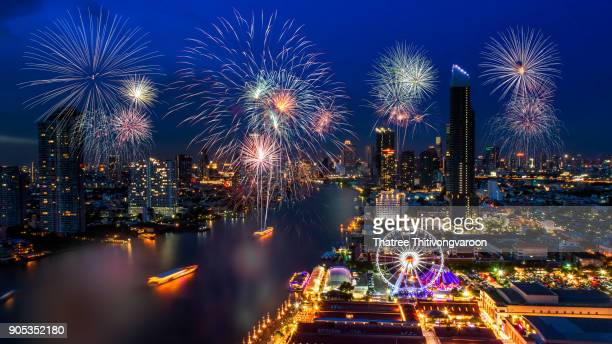 Celebration fireworks countdown,  Happy new year bangkok countdown 2018, Colorful of fireworks on the river at night with city background, Bangkok, Thailand.