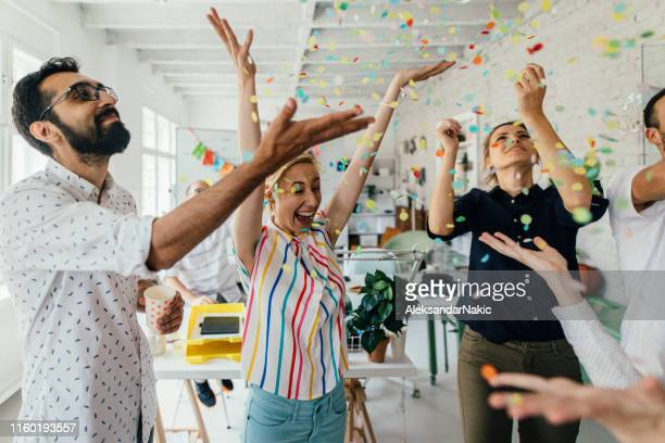 celebration in the office - celebration stock pictures, royalty-free photos & images