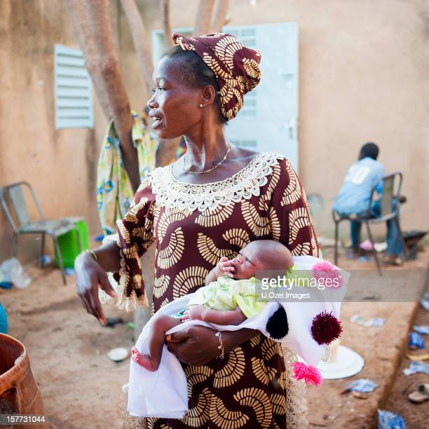 celebration of a newborn - burkina faso stock pictures, royalty-free photos & images
