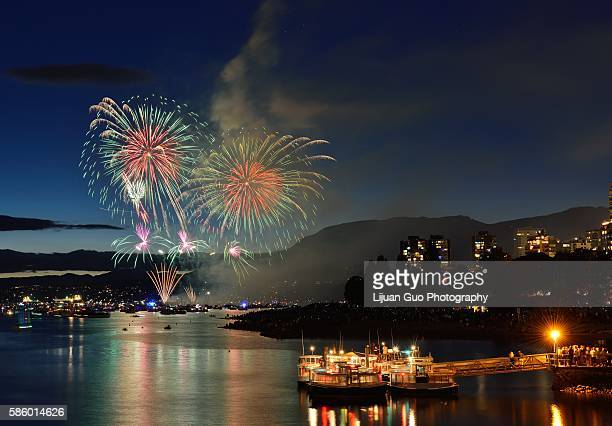 celebration of lights, fireworks display at english bay, vancouver, bc - english bay stock photos and pictures