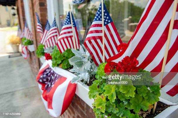 celebration of patriotic neighborhood with american flags - flag day stock pictures, royalty-free photos & images