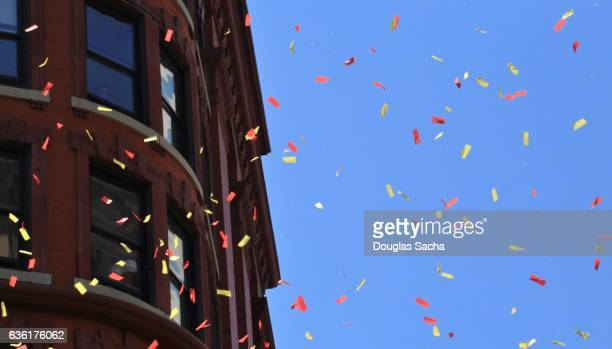 celebration parade confetti falling from downtown office buildings - ticker tape stock pictures, royalty-free photos & images