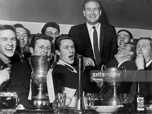 Celebration time for Alvechurch football club players following their FA Amateur Cup second round victory over Walthamstow Avenue Players chair their...