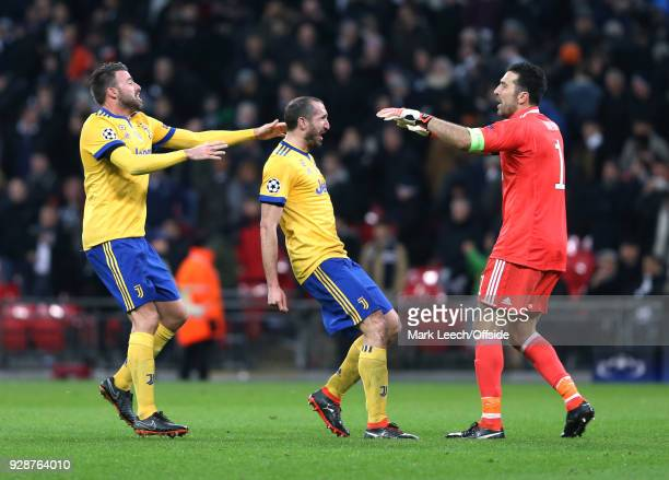 Celebration time for Juventus defenders Andreas Barzagli Giorgio Chiellini and goalkeeper Gianluigi Buffon during the UEFA Champions League Round of...