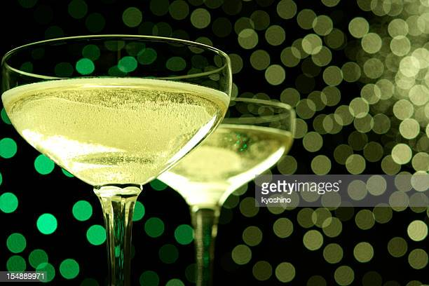 Celebration toast with champagne against illumination background