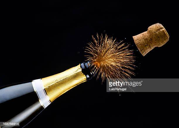 celebration with champagne - champagne cork stock photos and pictures