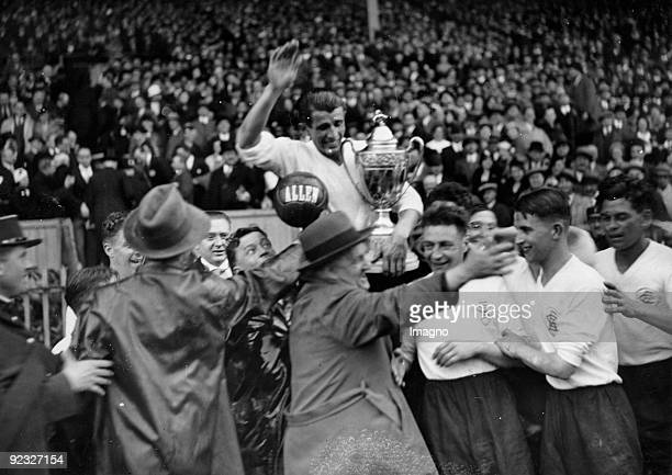 """Celebrations after a soccer match- Excelsior AC Roubaix wins the """"Coupe de France"""". Yves du Manoir, France. Photograph. May 7th 1933."""