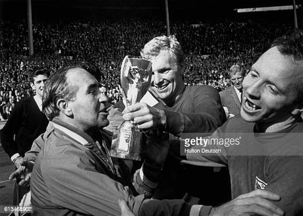 Celebrations following England's win over West Germany in the 1966 World Cup held at Wembley The England captain Bobby Moore holds the Jules Rimmet...