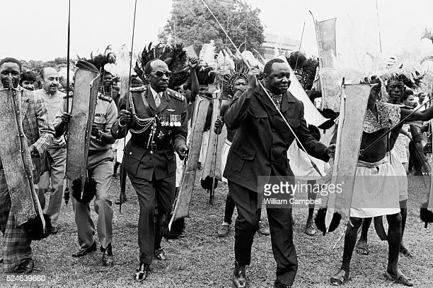 Celebrations get underway for the 6th anniversary of Idi Amin's accession to power as Idi Amin takes centre-stage among the local dancers.