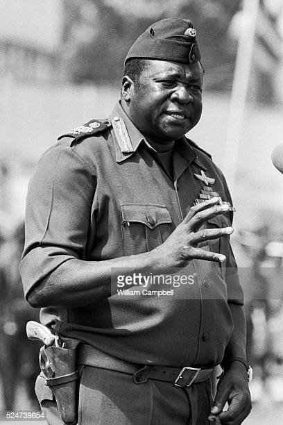 Celebrations get underway to celebrate Idi Amin's 6th anniversary in power. Amin making a speech in front of his troops.