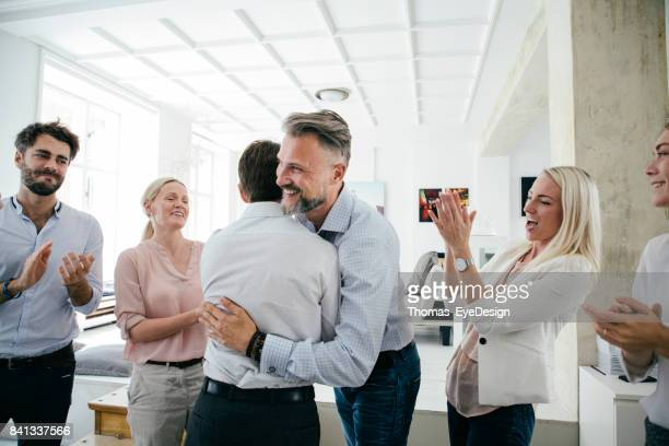 celebrations in office after successful business pitch by team - celebration stock pictures, royalty-free photos & images