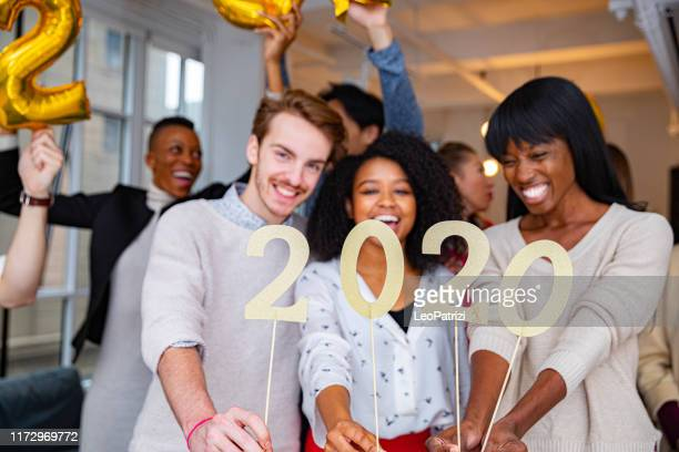 2020 celebrations new year's eve in the ny office - new year 2020 stock photos and pictures