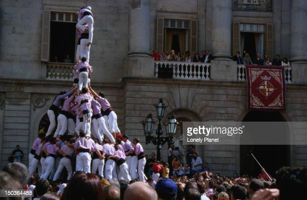 Celebrations underway for Festes de la Merce (Catalunya's National Day) with castellers (or human pyramid builders) on Placa Sant Jaume in Barri Gotic.