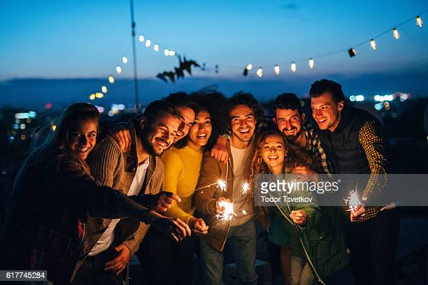 celebratng on the roof - fun night party stock photos and pictures