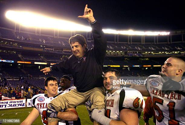 A celebratory Texas Tech coach Mike Leach is hoisted by Mike Smith and Cody Campbell as Dek Bake watches after 4531 victory over Cal in the Pacific...