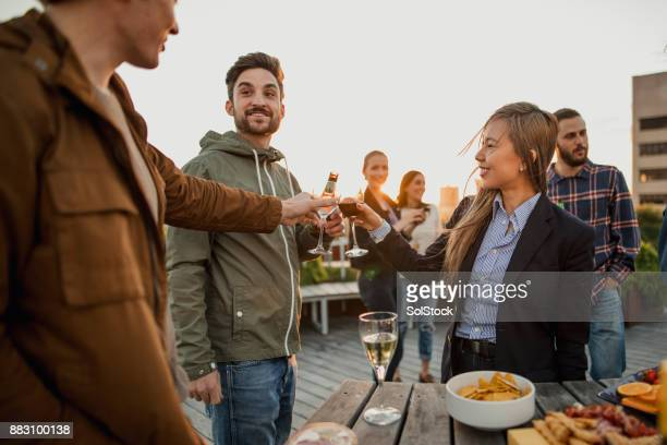 Celebratory Toast at the Rooftop Party