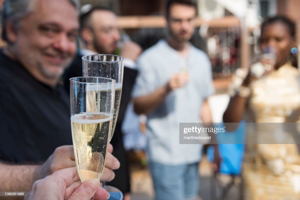 Celebratory toast at wedding cocktail in backyard. : Stock Photo