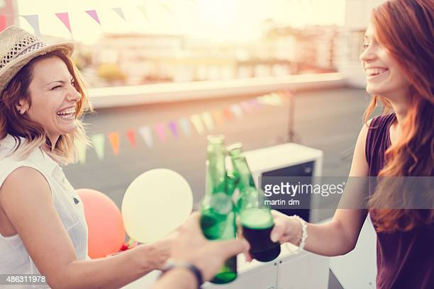 Celebratory toast on the rooftop for a birthday party