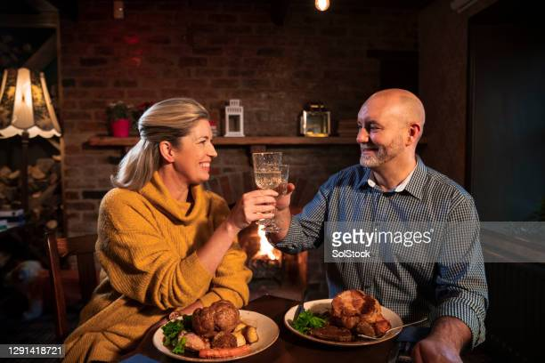 celebratory toast - pub stock pictures, royalty-free photos & images