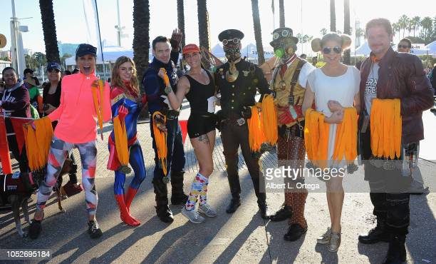 Celebrities and cosplayers celebrate the first female runner at Easter Seals Southern California's 'Strides For Disability 5K Run/Walk and 3K Family...
