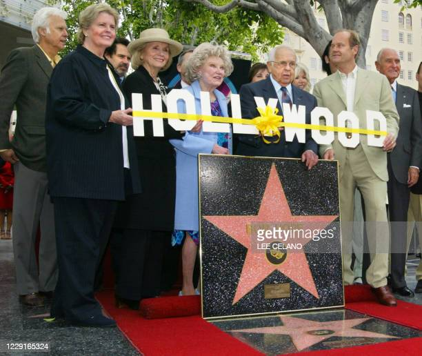 """Celebrities and dignitaries pose with a special plaque naming entertainer Bob Hope as """"Citizen of the Century"""" during a dedication ceremony on the..."""