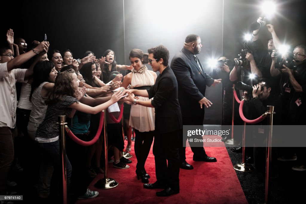 Celebrities arriving on red carpet : Stock Photo