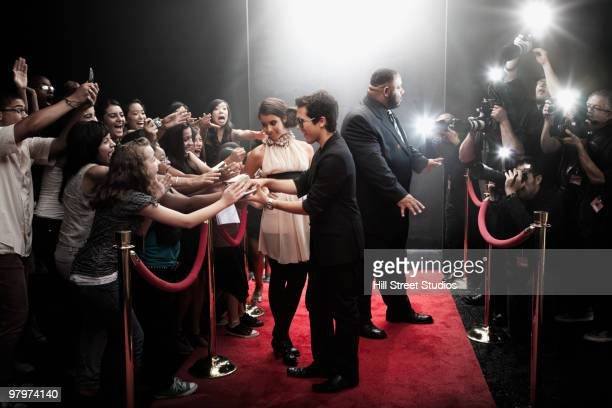 celebrities arriving on red carpet - girls flashing camera stock pictures, royalty-free photos & images