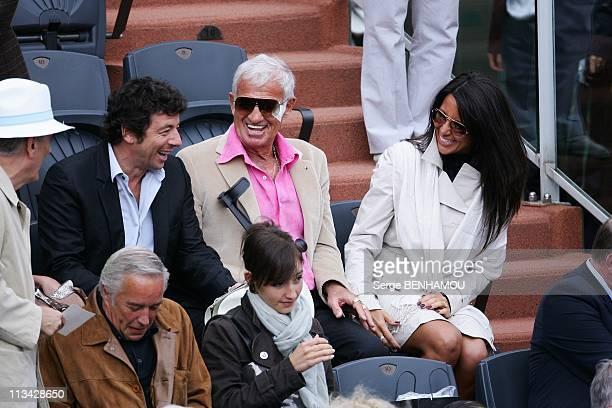 Celebrities At 2009 Roland Garros Tournament In Paris France On June 07 2009 Patrick Bruel JeanPaul Belmondo Barbara Gandolfi