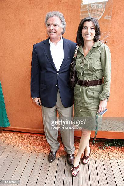 Celebrities At 2009 Roland Garros Tournament In Paris France On May 27 2009 Alain Afflelou and Christine