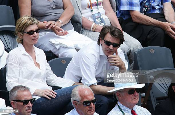 Celebrities At 2009 Roland Garros Tournament In Paris, France On May 31, 2009 - Michele Laroque and Francois Baroin.