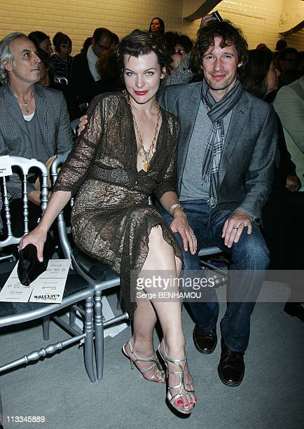 Celebrities At Gaultier Ready To Wear SpringSummer 2009 Fashion Show In Paris France On September 30 2008 Milla Jovovich and her friend Paul W...