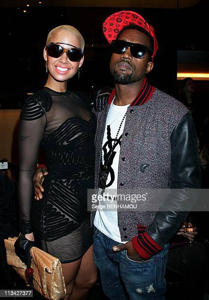 Celebrities At Sonia Rykiel FallWinter 20092010 Ready To Wear Fashion Show In Paris France On March 08 2009 Amber Rose and Kanye West