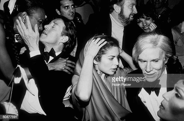 Celebrities during New Year's Eve party at Studio 54 Halston Bianca Jagger Jack Haley Jr and wife Liza Minnelli and Andy Warhol
