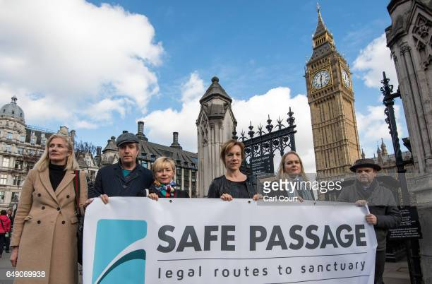 Celebrities including Toby Jones Juliet Stevenson Rhys Ifans and Joely Richardson hold a banner outside Parliament as they take part in a protest to...