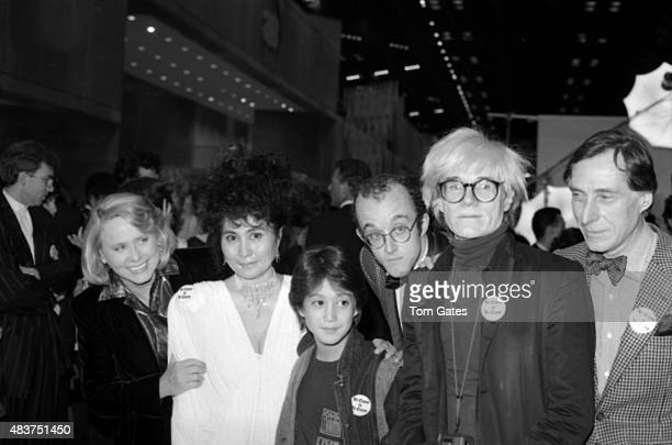 Celebrities Liz Smith Yoko Ono Sean Ono Lennon Keith Haring Andy Warhol and Andre Gregory attend an AIDS Benefit in April 1986 in New York City New...