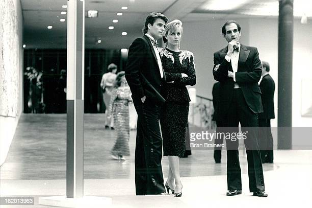 JAN 27 1987 Celebrities ponder art works at the Denver Art Museum Richard Teitz with Ted McGinley Shawn Weatherly