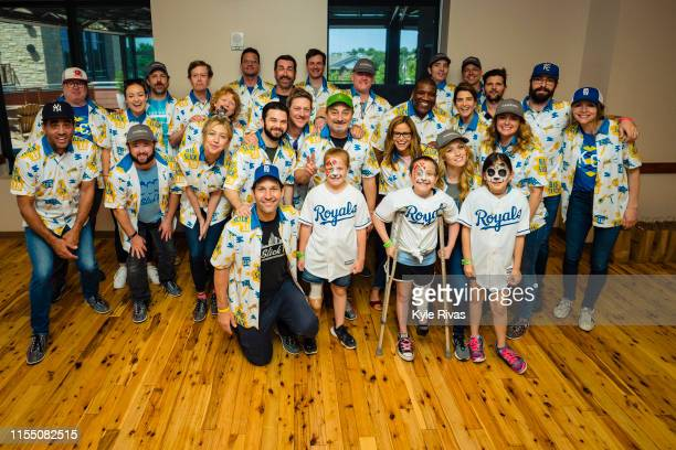 Celebrities pose for a photo with patients from Children's Mercy Hospital after participating in bowling at Pinstripes during the Big Slick Celebrity...