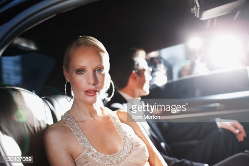 celebrities posing for paparazzi in backseat of car stock