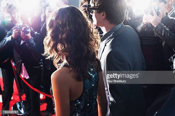 celebrities posing for paparazzi on red carpet - red carpet event stock pictures, royalty-free photos & images