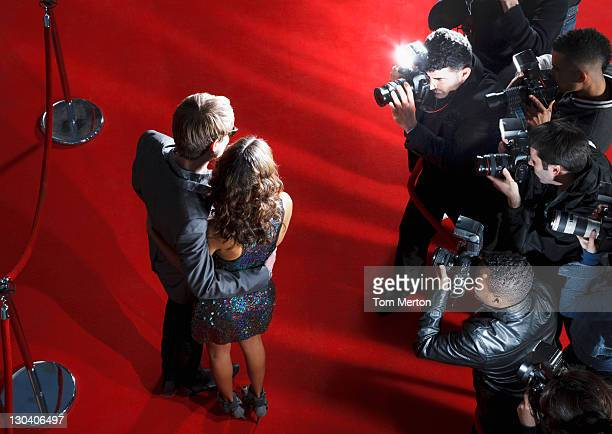 celebrities posing for paparazzi on red carpet - celebrities stock pictures, royalty-free photos & images