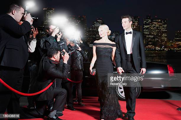 celebrities posing for paparazzi on red carpet - dinner jacket stock pictures, royalty-free photos & images