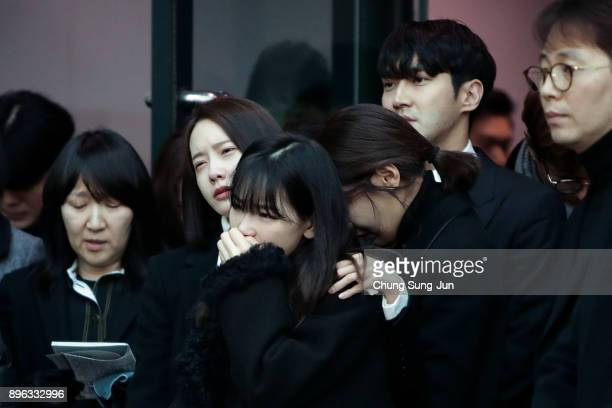 Celebrities react during the funeral of Jonghyun of SHINee at the hospital on December 21 2017 in Seoul South Korea The lead vocalist of the Kpop...