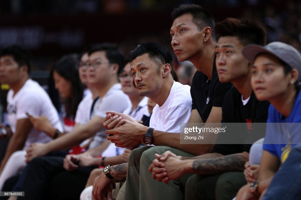 Celebrities Shawn Yue and Yi Jianlian take in the game between the Minnesota Timberwolves and the Golden State Warriors as part of 2017 NBA Global Games China at Universidade Center on October 5, 2017 in Shenzhen, China.